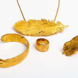 Armreif, Ringe und Anhänger in Silber mit Gold platiniert
